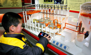 A Chinese boy tries out a nuclear power simulator at the Wuhan Science and Technology Museum in Wuhan, Hubei province, 19 Feb. 2010. China's energy planners said they aim to have 40 reactors by 2020.