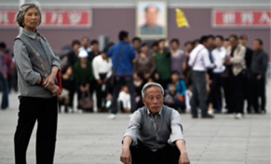 "Elderly Chinese people visiting Tiananmen Square in Beijing, China, Apr. 28, 2011. China's population is aging rapidly. The data from a national census carried out late in 2010 will fuel debate about whether China should continue its ""one-child"" policy."