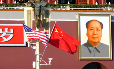 Chinese and U.S. flags flutter on a lamppost in front of the portrait of Mao Zedong on the Tiananmen Square to welcome the visit of U.S. President Barack Obama in Beijing, China, 17 November 2009.