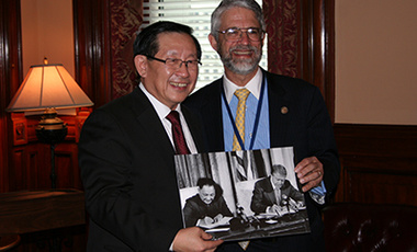 In 2011, science advisors to the presidents of China and the United States, Wan Gang and John P. Holdren, hold a photo of the historic 1979 U.S.-China agreement on science and engineering.