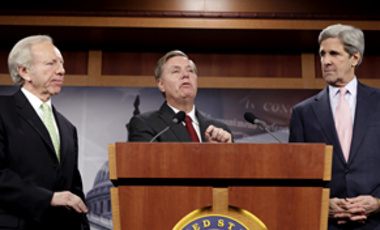 From left, Sen. Joseph Lieberman, I-Conn., Sen. Lindsey Graham, R-S.C., and Sen John Kerry D-Mass. on Capitol Hill, Dec. 10, 2009, during a news conference to discuss comprehensive climate change and energy independence legislation.