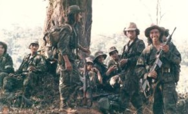 ARDE Frente Sur Commandos (Contras) take a smoke break after routing a Sandinista National Liberation Front base at El Serrano, Southeast Nicaragua 1987.