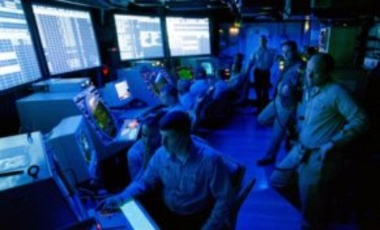 In this May 12, 1999, U.S. Navy handout photo, air traffic controllers monitor the radar screens of the Air Operations Center aboard the USS Theodore Roosevelt aircraft carrier in support of airstrikes against Yugoslavia.