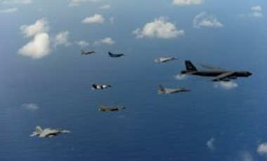 USAF, USN, Japan Air Self-Defense Force & Royal Australian Air Force aircraft in formation over the Pacific Ocean in support of Cope North 2014, Feb. 18, 2014. Cope North is an annual air combat tactics, humanitarian assistance & disaster relief exercise.