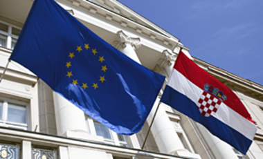 Croatian and EU flags in St. Mark square in Zagreb, Croatia, May 24, 2010. Croatia is next in line to join the EU, but with the plunge in the euro's value, many worry that the EU's planned enlargement may have lost its appeal.