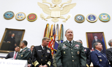 Army Gen. Keith B. Alexander, commander of the U.S. Cyber Command, center, arrives on Capitol Hill in Washington, Sept. 23, 2010, to testify before the House Armed Services Committee hearing on cyberspace operations.
