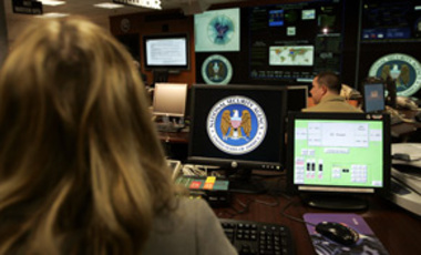Employees of the National Security Agency sit in the Threat Operations Center on Jan. 25, 2006, in Fort Meade, Md. The government issued an alert Nov. 30, 2006 to U.S. stock market and banking Web sites about a possible Internet attack.