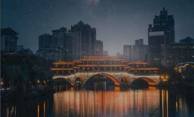 traditional chinese bridge with skyscrapers in the background