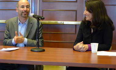 Middle East Initiative fellow Diana Buttu talks with Robert Malley, program director for the Middle East and North Africa at International Crisis Group, following his lecture at Harvard Kennedy School.
