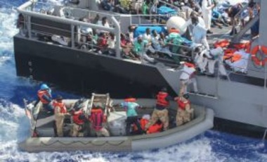 Distressed persons are transferred from the amphibious transport dock ship USS San Antonio (LPD 17) to Armed Forces of Malta offshore patrol vessel P52. San Antonio rescued 128 men adrift in an inflatable raft after a call by the Maltese Government.