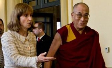 Former U.S. Undersecretary of State Paula Dobriansky, left, walked with the Dalai Lama to their meeting, Monday, April 21, 2008, in Ann Arbor, Mich.