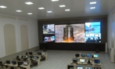 Scientists and technicians at the General Satellite Control and Command Center on the outskirts of Pyongyang watch the successful launch of the Unha-3 rocket from the west coast, about 56 km from the Chinese border, Dec. 12, 2012.