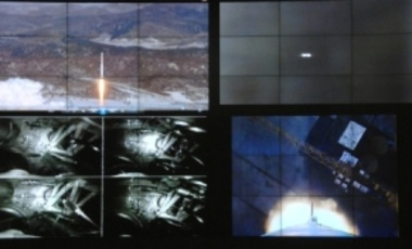 Various images shown on screens at the General Satellite Control and Command Center show the launch of North Korea's Unha-3 rocket, Dec. 12, 2012, in Pyongyang, North Korea.