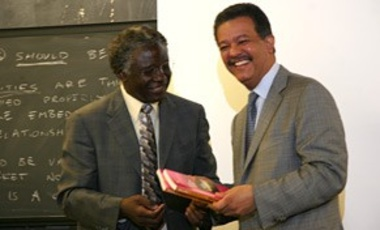 Professor Calestous Juma, Harvard University presents to President Leonel Fernandez the Millennium Project's Science, Technology and Innovation Millennium Development Goals (MDG) Report
