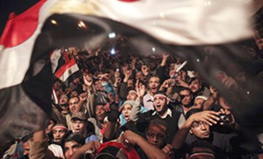 Egyptians celebrate the news of the resignation of President Hosni Mubarak, who handed control of the country to the military, in Tahrir Square in downtown Cairo, Egypt.