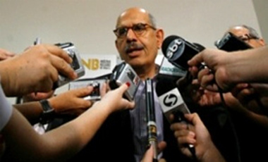Mohamed ElBaradei, then director general of the International Atomic Energy Agency, speaks to reporters.