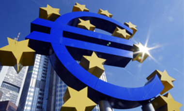 In this Sept. 21, 2007 file picture the Euro sign is photographed in front of the European Central Bank in Frankfurt, Germany.