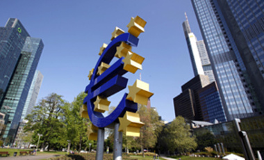 The Euro sculpture sits in front of the European Central Bank in Frankfurt, Germany, Apr. 28, 2010. Three weeks away from potential default, Greece saw its borrowing costs spiral higher, a day after Standard & Poor's downgraded its bonds to junk status.