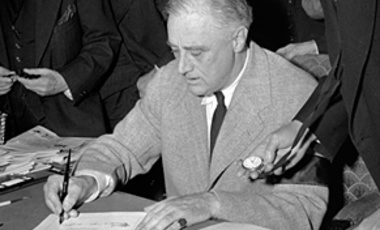 President Franklin Roosevelt signing declaration of war against Germany at the White House December 11, 1941.