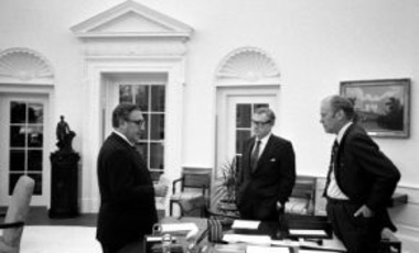President Gerald Ford meets in the Oval Office with Secretary of State Henry A. Kissinger and Vice President Nelson A. Rockefeller to discuss the American evacuation of Saigon, Oval Office, White House, Washington D.C., April 28, 1975.