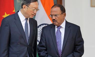 Indian National Security Adviser Ajit Doval, right, talks with Chinese State Councillor Yang Jiechi before their delegation-level meeting in New Delhi, India
