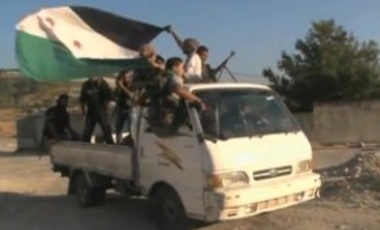 Free Syrian Army soldiers being transported by pick up truck, August 20, 2012.