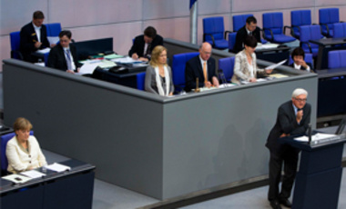 German Chancellor Angela Merkel, left, listens to opposition Social Democratic Party floor leader Frank-Walter Steinmeier, right, during a debate about a bailout package for Greece at the German parliament Bundestag in Berlin, June 10, 2011.