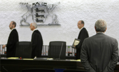 June 5, 2008: Gotthard Lerch, right, watches the judges entering the courtroom in Stuttgart, Germany. He admitted to helping procure centrifuge parts for Libya, was convicted in 2008 on minor charges, and sentenced to time served in pretrial detention.