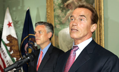 Utah Gov. Jon Huntsman, left, listens to Calif. Gov. Arnold Schwarzenegger before signing the Western Regional Climate Action Initiative, 21 May 2007, in Salt Lake City. The pact calls for a cap to GHG emissions and an emissions-trading program.