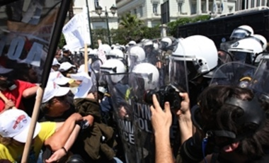 Protesters clash with riot police in Athens, May 4, 2010. Greece's government announced sweeping spending cuts worth 30 billion euros through 2012, in order to secure a vital rescue package of loans from the IMF and the 15 EU countries using the euro.