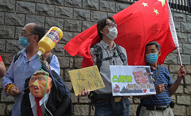 Pro-China supporters hold the effigy of U.S. President Donald Trump and Chinese national flag outside the U.S. Consulate during a protest, in Hong Kong, Saturday, May 30, 2020. President Donald Trump has announced a series of measures aimed at China as a rift between the two countries grows.