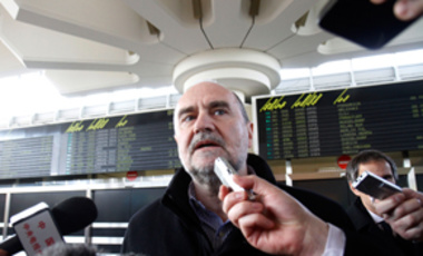 Herman Nackaerts, Deputy Director General and Head of the Department of Safeguards of the International Atomic Energy Agency is interviewed as he arrives after his flight from Iran at Vienna's Schwechat airport, Austria, Feb. 1, 2012.
