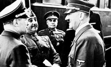 German Chancellor Adolf Hitler, right, clasps hands with Spain's Generalissimo Franco, in Hendaye, France, Oct. 23, 1940.