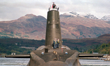 File photo of HMS Vanguard, one of UK's Trident nuclear submarines. Prime Minister Gordon Brown told world leaders meeting in New York that he is considering cutting the UK's fleet of Trident submarines from 4 to 3, Sep. 23, 2009.