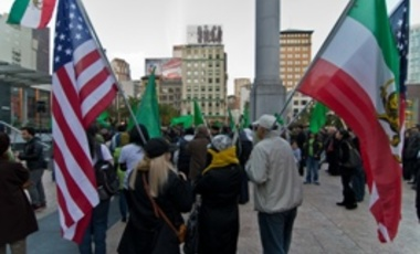 Marchers in San Francisco's Union Square wave American and pre-1979 Iranian Flags in February, 2011.