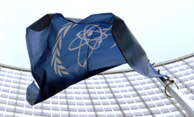 The flag of the International Atomic Energy Agency (IAEA) flies in front of the Vienna headquarters at the Vienna International Center on March 27, 2009.