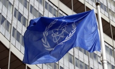 The flag of the International Atomic Energy Agency blowing in the wind at IAEA headquarters in Vienna