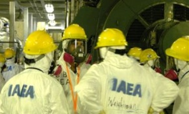 May 27, 2011: IAEA fact-finding team members visit the emergency diesel generator at Reactor Unit 6 at the Fukushima Dai-ichi nuclear plant in Okuma, Japan. The generator was the only one to survive the March 11 earthquake and tsunami.