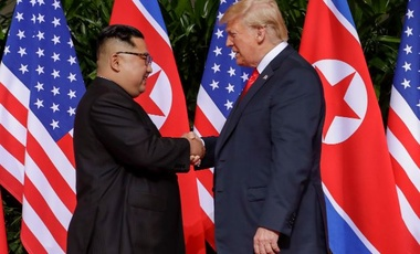 President Trump and Chairman Kim shaking hands at Singapore Summit