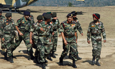 Indian Army Chief Gen. Deepak Kapoor, front second right, arrives at an army base in Beerwah during a two-day visit to Indian Kashmir.