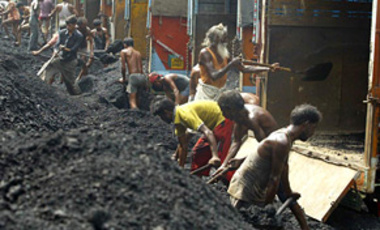 Laborers loud coal onto trucks on the outskirts of Jammu, India, Aug. 2, 2007. Coal from different Indian states is distributed in Jammu and Kashmir for industrial and domestic purposes.