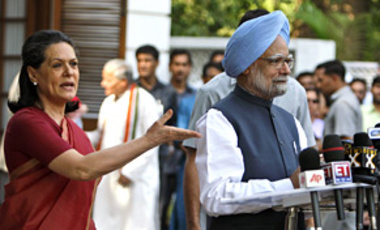 Congress party President Sonia Gandhi, left, requests Indian Prime Minister Manmohan Singh to address the media after election results suggested a mandate in favor of Congress and its allies in the just concluded polls in New Delhi, India, May 16, 2009.