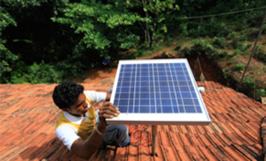 May 25, 2011: Sharan Pinto installs a solar panel antenna on a house roof in Nada, India. Across India, small companies and aid programs are bypassing the central electricity grid to deliver solar panels to the rural poor.
