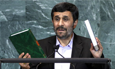 Mahmoud Ahmadinejad, President of Iran, holds up a copies of the Quran, left, and Bible, right, as he addresses the 65th session of the United Nations General Assembly at UN headquarters, Sep. 23, 2010.