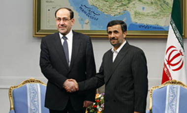 Iranian President Mahmoud Ahmadinejad, right, shakes hands with Iraqi Prime Minister Nouri al-Maliki, in Tehran, Oct. 18, 2010. Iran gave its clearest nod of support to al-Maliki as he lines up backing from key neighbors in his bid to remain in office.