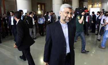 Iranian top nuclear negotiator Saeed Jalili smiles after Foreign Minister Manouchehr Mottaki signed an agreement to ship most of Iran's enriched uranium to Turkey in a nuclear fuel swap deal, in Tehran, Iran, May 17, 2010.
