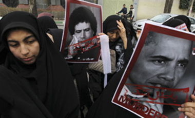 Pro-Iranian government female demonstrators protest against U.S. President Barack Obama & Libyan leader Moammar Gadhafi in support of anti-government Libyan & Yemeni protestors in front of the UN office in Tehran, Iran, Feb. 24, 2011.