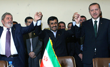 Brazil's President Luiz Inacio Lula da Silva, Iran's President Mahmoud Ahmadinejad and Turkish Prime Minister Recep Tayyip Erdogan celebrate the signing of a nuclear fuel swap agreement among the countries, in Tehran, on May 17, 2010.