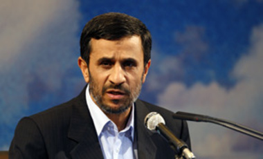"Iranian President Mahmoud Ahmadinejad speaks at a press conference in Tehran, Sep. 7, 2009. He said Iran will neither halt uranium enrichment nor negotiate over its nuclear rights but is ready to sit and talk with world powers over ""global challenges."""