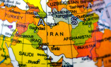 A close up of IRAN on a globe.